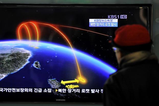 In Seoul, a man watches a TV screen broadcasting news about North Korea's rocket launch. On 12 December, North Korea launched a long-range rocket which Japanese authorities said passed over its southern island chain of Okinawa. AFP