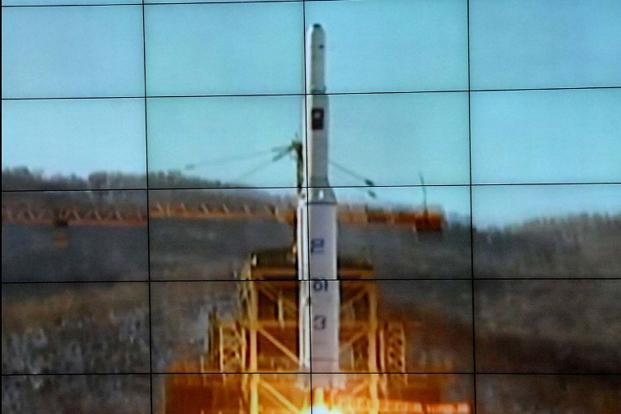 Rocket Unha-3, carrying the satellite Kwangmyongsong-3, being monitored on a large screen at a satellite control centre in Cholsan, North Korea. North Korea confirmed it had launched a long-range rocket. AFP/Korean Central News Agency