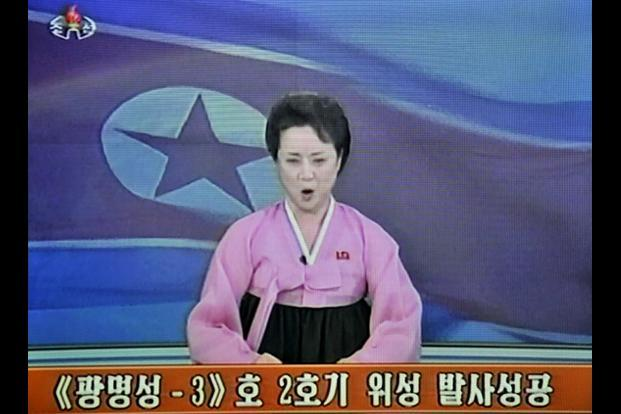 "This screen grab from North Korean TV shows a female announcer wearing a pink ""hanbok, the traditional Korean national dress, reading a statement on the country's long-range rocket launch. AFP/North Korean TV"