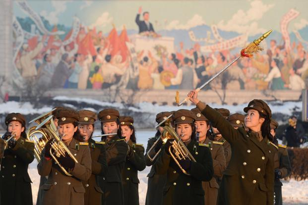 A North Korean military band performs to celebrate the country's rocket launch in front of a triumphal gateway in Pyongyang. It was the country's second launch this year, after a failed attempt in April. Reuters/Kyodo