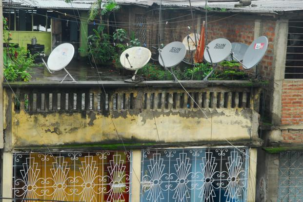 The rural media consumer is discriminating as even the fairly poor will opt for a paid DTH service over a free one because he wants a choice of channels, good local news, a good dose of sports, and access to better serials and films. Photo: Indranil Bhoumik/Mint