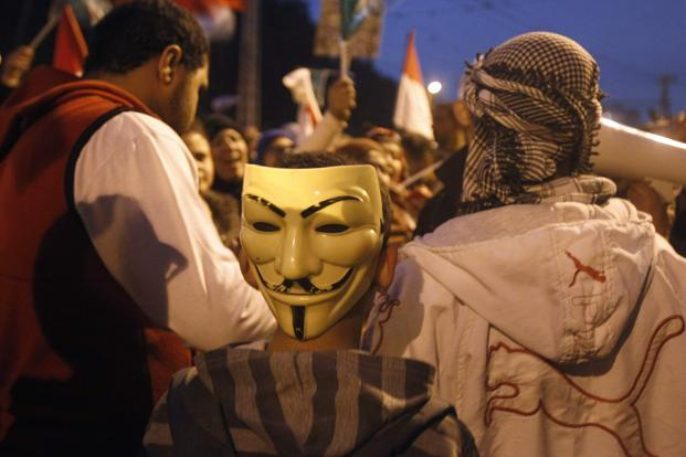 A protester opposing Egyptian President Mohamed Mursi wears a Guy Fawkes mask on his head during a demonstration outside the presidential palace in Cairo on Friday. Photo: Khaled Abdullah/Reuters