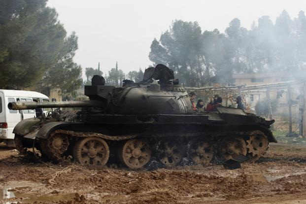 A damaged tank is seen after Free Syrian Army fighters captured the Military Infantry School following heavy clashes with forces loyal to President Bashar al-Assad in Aleppo on Sunday. Photo: Zain Karam/Reuters
