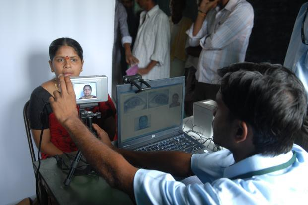 A file photo of residents being enrolled for the Aadhaar programme in Tumkur district, Karnataka. While UIDAI is mandated to issue 600 million Aadhaar numbers by 2014, so far 200 million, or about 16% of the population, have got them. Photo: Hemant Mishra/Mint