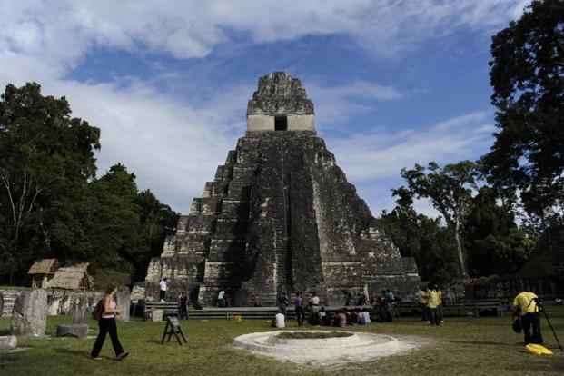"Tourists are seen in front of the ""Gran Jaguar"" Mayan temple at the Tikal archaeological site in Peten departament, Guatemala City. Ceremonies will be held here to celebrate the end of the Mayan cycle."