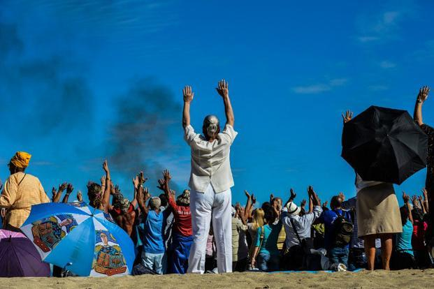 Cubans participate in a Mayan ritual at Bacuranao beach in Havana on 6 December.