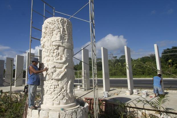 A worker puts finishing touches before the opening of Santuario de la Esperanza (Sanctuary of Hope) similar to the Mayan steles (monuments) in Cancún, Mexico.