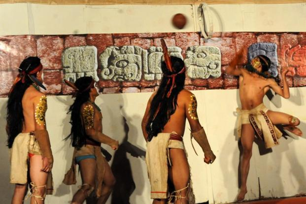 Honduras's Maya Chorti and Guatemala´s Quirigua vie for the ball in Copan Ruinas, Honduras. The ancient Mayan ball game is part of celebrations that will finish on 21 December.