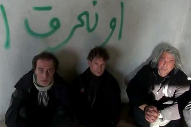 An image grab taken from a video uploaded on YouTube allegedly shows US television journalist Richard Engel (centre) with the representative of NBC in Turkey Aziz Akyavas (left) and NBC's journalist in New York John Kooistra (right) during their detention. NBC had attempted to keep the crew's disappearance secret but several media outlets ignored the requested blackout. Photo: AFP