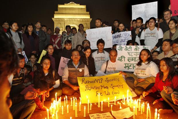 Volunteers participate in a candle-light vigil at India Gate in New Delhi.