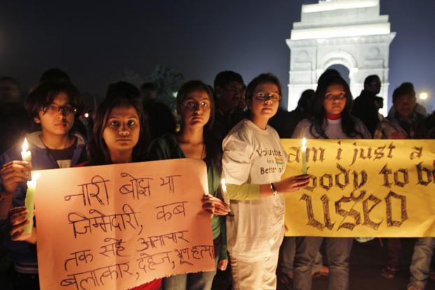 Protestors carry placards demanding measures to ensure the safety of women in New Delhi.