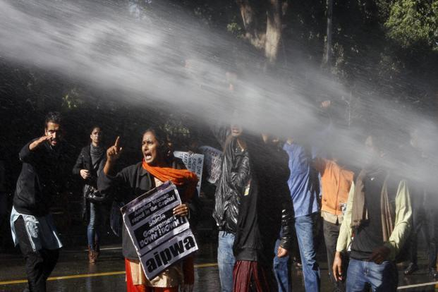 Police use water cannons to disperse the protesters who tried to bring down metal barricades outside Delhi chief minister Sheila Dikshit's home. Photos: Hindustan Times