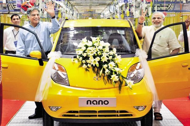 A June 2010 photo of Ratan Tata (left) and Gujarat chief minister Narendra Modi at the roll-out the first Nano from the Sanand plant. Photo: AP