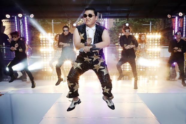 "Psy's infectious viral hit song, ""Gangnam Style,"" made history on Friday as the first ever video on YouTube to reach 1 billion views, adding yet another record to the song's juggernaut journey into mainstream pop. Photo: Reuters"