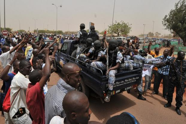 A file photo of Malian military junta supporters surrounding a car loaded with soldiers at Bamako airport, March 2012, in Bamako. The UNSC on Thursday approved a resolution allowing the deployment of an African force in Mali to prepare an offensive against Al-Qaeda linked militants. Photo: AFP