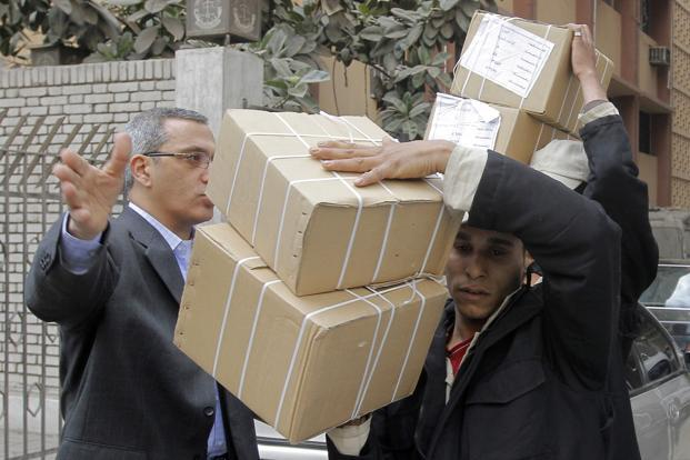 An Egyptian judge directs soldiers carrying ballots in Giza, Egypt, on Friday, a day before the second round of voting on a new constitution. Photo: AP