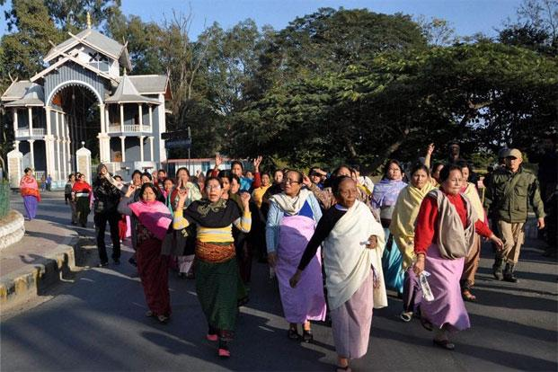 Women shout slogans at a protest against the alleged molestation of a film actor by a NSCN(IM) militant in Imphal on Saturday. Photo: PTI