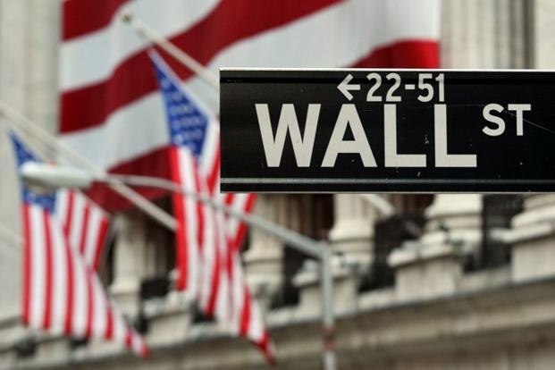 A file photo of the Wall Street sign near the front of the New York Stock Exchange. Photo: AFP