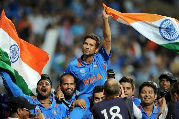 Sachin Tendulkar is carried by his teammates after India won the 2011 World Cup 2011. Photo: William West/AFP