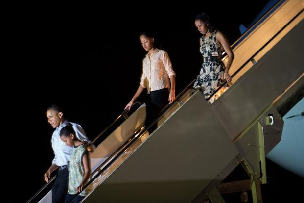 US President Barack Obama with his daughters Sasha and Malia, and wife Michelle Obama in Honolulu, Hawaii, on 22 December. Photo: Jim Watson/ AFP