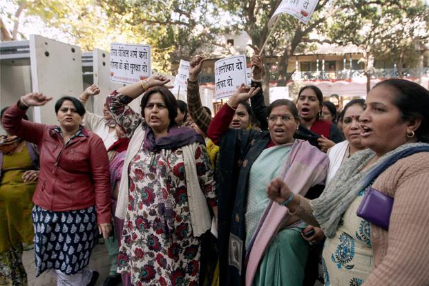 Women activists raise slogans during a protest at Jantar Mantar last week. A private chartered air ambulance belonging to ARE Airways, which is equipped with sophisticated ICU facilities, took off at around 11.45pm on Wednesday. Photo: PTI