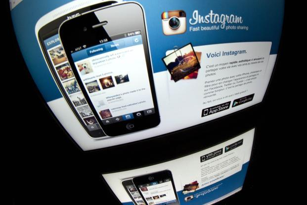 In announcing revised terms of service last week, Instagram spurred suspicions that it would sell user photos without compensation. Photo: Lionel Bonaventure/AFP