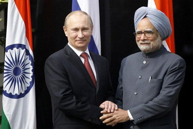 Russian President Vladimir Putin (left) shakes hands with Indian Prime Minister Manmohan Singh ahead of a meeting at Singh's residence in New Delhi on Monday. Photo: AFP
