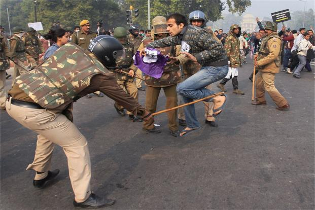 Police charge protesters at Rajpath in New Delhi on Sunday. Photo: PTI
