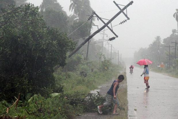 A file photo of residents battling Typhoon Bopha in southern island of Mindanao in the Philippines. The Philippines is hit by about 20 major storms or typhoons each year that occur mainly during the rainy season between June and October. Photo: AFP