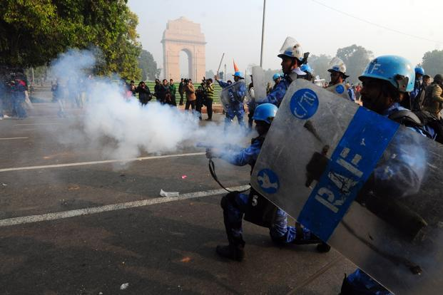 Personnel from the Rapid Action Force lobbed around 150 teargas shells to disperse the protesters on Sunday. Ramesh Pathania/Mint