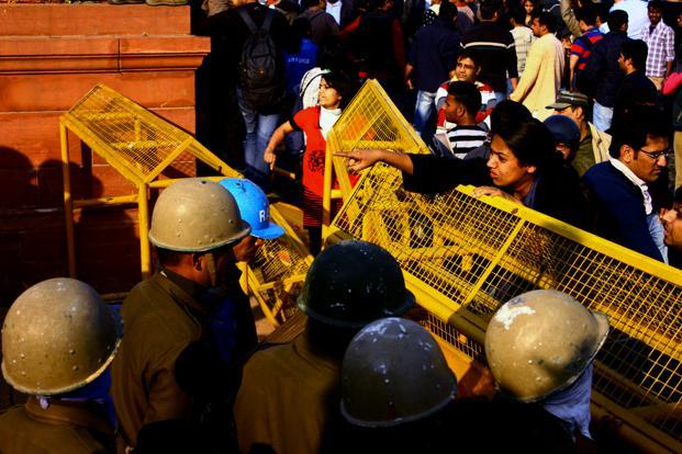 A woman confronts police personnel after she was beaten up during the lathi charge. Government figures show that the number of rapes in Delhi have risen 17% to 661 this year. Pooja Chaturvedi/Mint