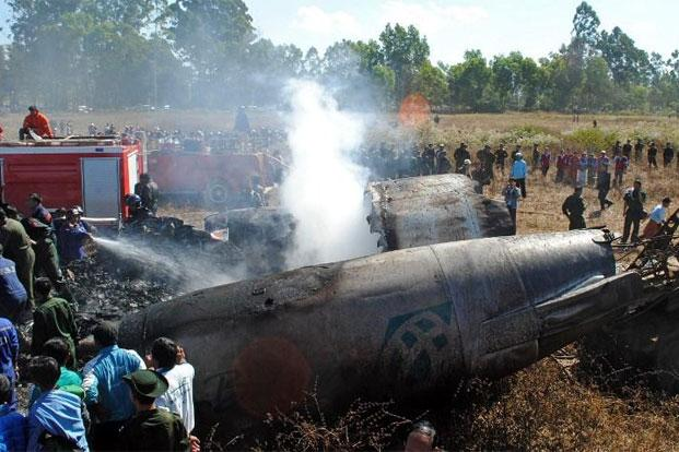 Rescue personnel working at the scene of the Air Bagan plane crash near Heho airport in Myanmar's eastern Shan state on Tuesday. Photo: AFP