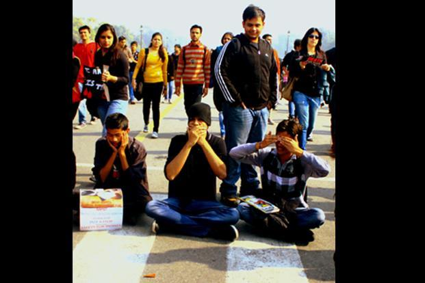 The beginning of the protests was largely peaceful. Here, three boys, sit in front of Rashtrapati Bhavan, mimicing Gandhi's three monkeys, asking people not to tolerate (see, hear and speak) violence against women. Pooja Chaturvedi/Mint