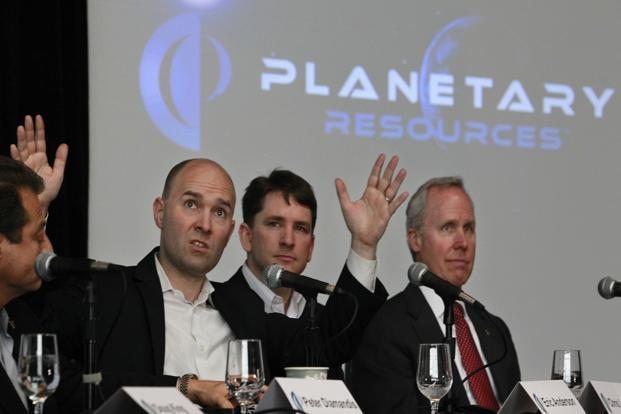An April photo of Planetary Resources co-founder and co-chairman Eric Anderson, second from left, during a press conference in Seattle, US.