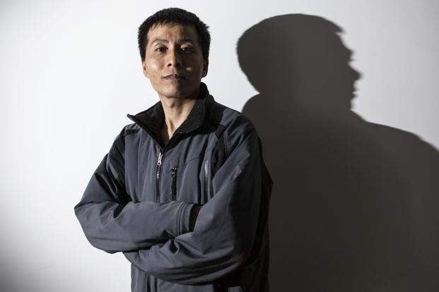 Zhu Ruifeng is a Beijing journalist who has exposed more than a hundred cases of alleged corruption. Photo: Shiho Fukada/NYT