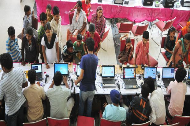 People getting enrolled under the Aadhaar programme in New Delhi. The beneficiary's bank account will be directly credited with the money using Aadhaar-based identification. Photo: Ramesh Pathania/Mint