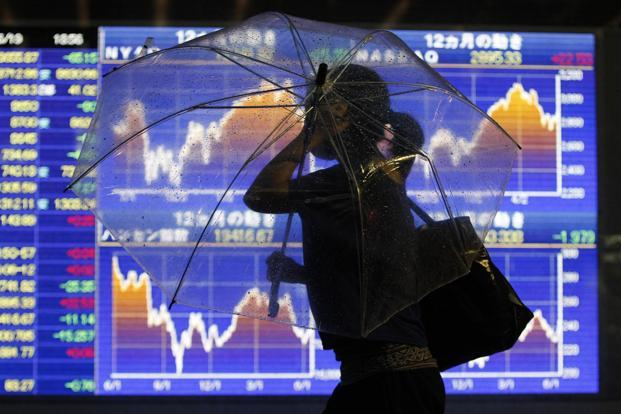 Asian shares and other assets were capped in thin holiday trade, with investors focusing on the fate of US negotiations to avert a budget crunch looming at the end of the year. Photo: Reuters