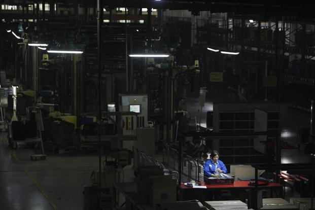 A worker in a Chinese factory on the outskirts of Shanghai. A second month of strong double-digit profit growth reinforces the view of analysts that China's economy has gathered momentum in the fourth quarter. Photo:Reuters