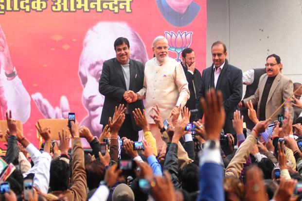 BJP president Nitin Gadkari and Gujarat chief minister Narendra Modi at the party headquarters in New Delhi on Thursday. Photo: Ramesh Pathania/Mint