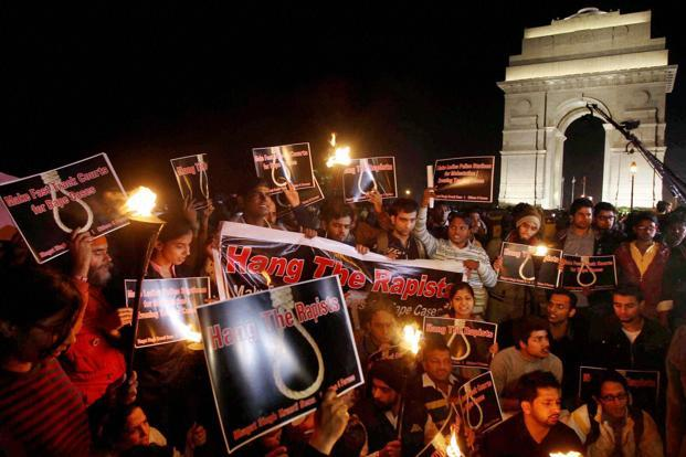 Youngsters protest at India Gate on Wednesday against the gang-rape of a 23-year-old girl in Delhi. Photo: Shahbaz Khan/PTI