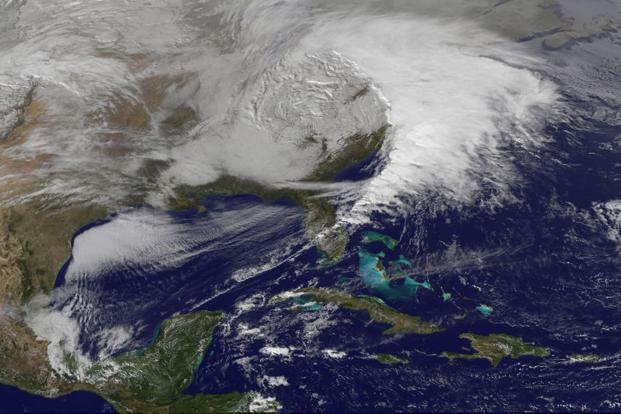 Storm clouds can be seen on the east coast of the US in this Nasa handout satellite image taken on Wednesday. Photo: Nasa via Reuters