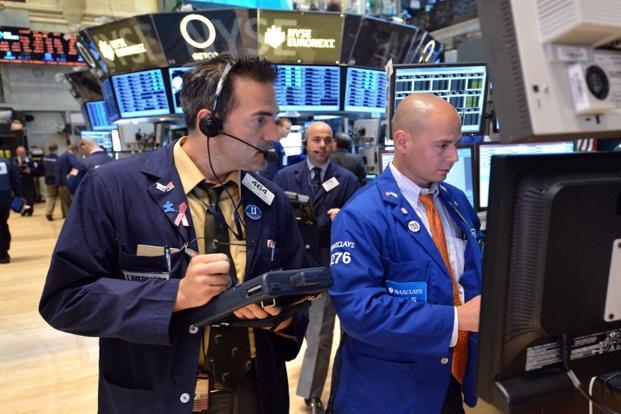 Dow was down 0.6%, S&P down 0.5% and Nasdaq down 0.3% on Friday afternoon. Photo: AFP