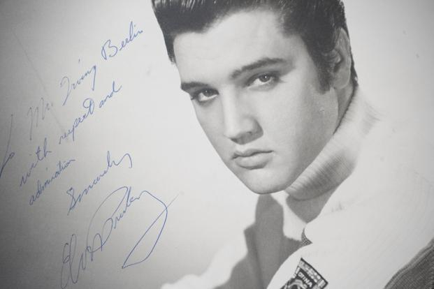 An original photograph of Elvis Presley autographed and inscribed to songwriter and composer Irving Berlin. Photo: Michael Loccisano/AFP