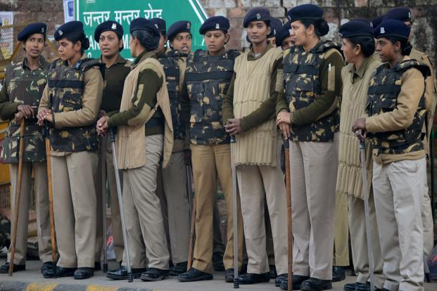 Police officials stand alert on a street in New Delhi on Saturday, as Indian leaders appealled for calm fearing fresh outbursts of protests after the death of a gang-rape victim. Photo: AFP