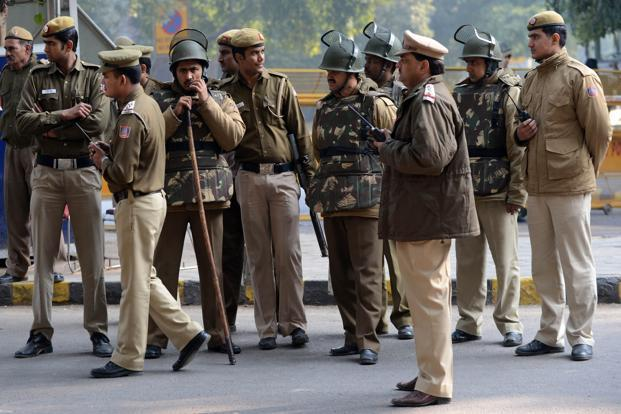 Police officials on alert in New Delhi on Saturday. Delhi chief minister Sheila Dikshit has urged people to mourn the death of the gang-rape victim in a peaceful manner. Photo: AFP