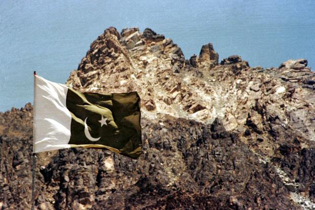 A Pakistan flag is seen hoisted in this file photograph taken in June 1998 on the Chaghi mountain after a nuclear test in May 1998. Photo: Reuters