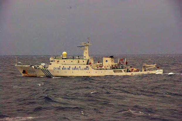 This handout picture taken by the Japan Coast Guard on 27 November shows a Chinese marine surveillance ship cruising near the disputed islands known as Senkaku islands Japanese and Diaoyu in Chinese in the East China Sea. Photo: AFP
