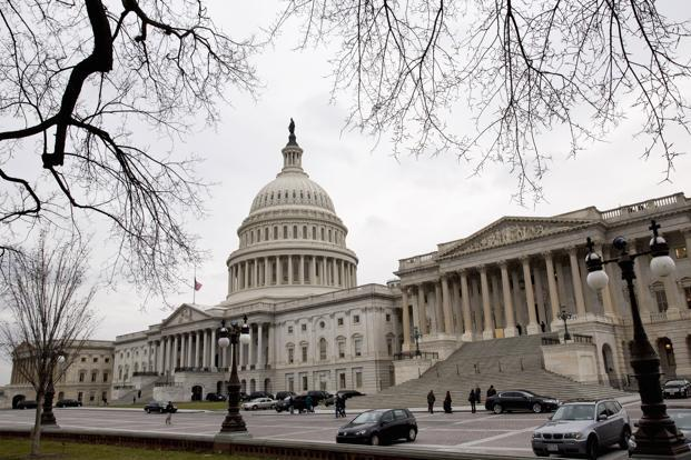 After months of agonizing over the crisis, weeks of debate about a possible solution, and days of intense, closed-door bartering, the US Senate voted overwhelmingly 89-8 early Tuesday to pass a controversial Bill that averts the so-called 'fiscal cliff'. Photo: Reuters
