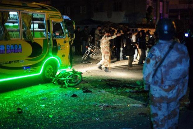 Pakistani security officials at the site of a bomb explosion in Karachi on Tuesday. Photo: AFP