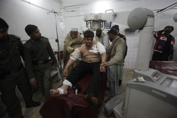 An injured driver who survived a shooting by unidentified gunmen in Swabi receives treatment at the Lady Reading Hospital in Peshawar. Gunmen ambushed and shot dead six Pakistani women aid workers and a male doctor on Tuesday. Photo:  Reuters